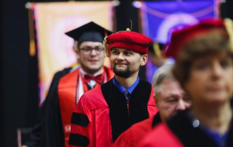 Alex Arnold '20, past president of the Parks and Recreations Student Society and student member of Cal U's Council of Trustees, at the winter Commencement ceremony in the Convocation Center, Dec. 14, 2019.