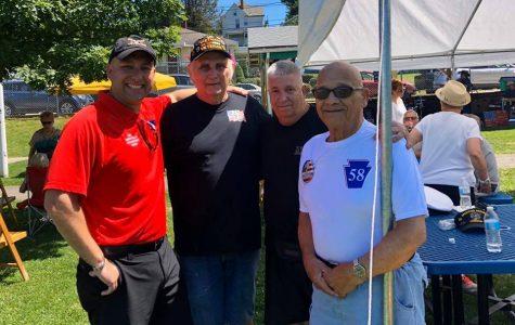 A gathering of military veterans (from left) Robert Prah, Jr., Bill Callaway, Jim Gardner, and Prah's grandfather, Nunzio Santo Colombo, at a Veteran's appreciation picnic at Community Bank Park in North Belle Vernon, June 2019.