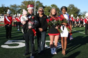 (FILE Oct. 12, 2019) Cal U President Geraldine M. Jones crowned Homecoming royalty during halftime at the football game on Oct. 12, 2019.  From left, Eric Townsend was crowned Homecoming King; Co-Queens were Maddie Rush and Cynthia Obiekezie.