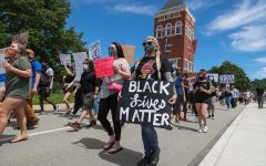 Hundreds march past the Booker Towers at California University of Pennsylvania in a