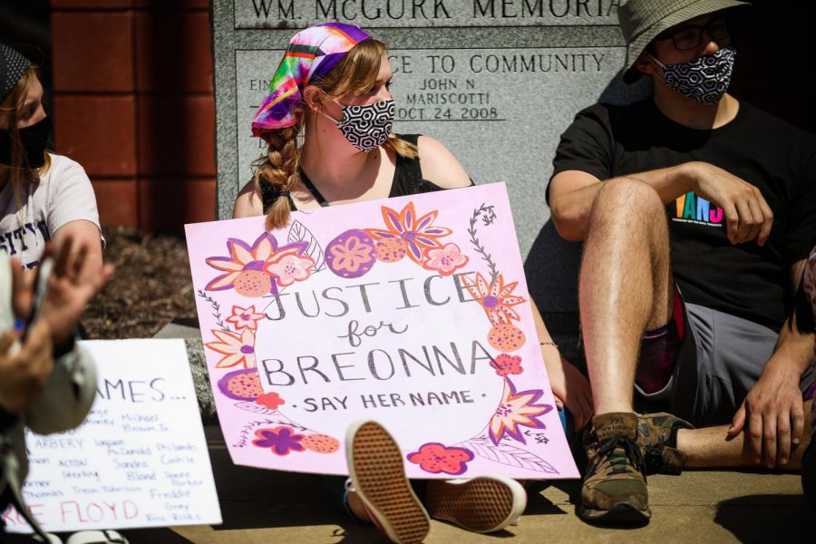 A demonstrator outside the California Borough Building displays