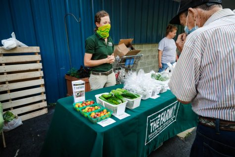"Morgan Livingston, agricultural innovation manager,  ""The Farm"" vending booth featuring fresh produce grown at the Greater Washington County Food Bank."