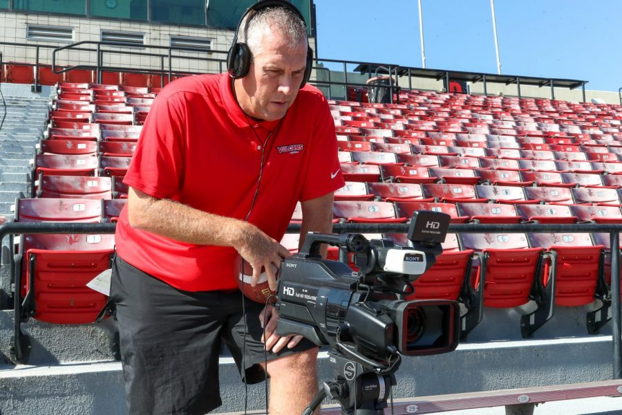 In the seats at Adamson Stadium, Head Football Coach Gary Dunn looks into the camera to review a video recording of his presentation for the upcoming Cal U Athletics Day of Giving fundraiser for scholarships set for Sept. 22, 2020.