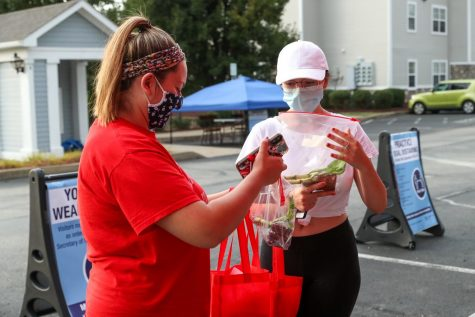 "First-year students Sarah Tinker, Masontown, Pa. and Taylor Tubbs, Smithfield, Pa. at a  California University of Pennsylvania ""Welcome Weekend"" event at the off-campus Vulcan Village apartments on Aug. 22."