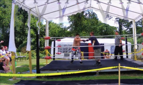 "Jonathan Sakaguchi, (on left) known in the ring as ""Timberwolve Jaxon Hawk,"" awaits the starting bell versus Gus Gardner in a recent Local Athletic Wrestling (LAW) ""Triple Threat Match"" at the Cassidy Compound, New Salem, Pa."