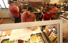 Workers in the food section of the Sheetz convenience store in Brownsville Pa. during the grand opening on Aug. 29, 2019.