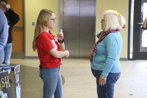 Maggie Cave (left), Panhellic President, speaking with Joy Helsel (right), Director or Sorority and Fraternity Life, at the spring 2020 Club & Organization Fair