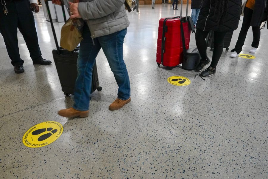 Yellow+dots+mark+the+spots+for+proper+social+distancing+as+travelers+line+up+to+board+an+Amtrak+train+%2C+Tuesday%2C+Nov.+24%2C+2020%2C+in+New+York%27s+Penn+Station.++Gov.+Andrew+Cuomo+urged+New+Yorkers+to+just+say+no+to+Thanksgiving+gatherings+to+help+reduce+COVID-19+infections+and+hospitalizations%2C+which+he+said+are+rising+at+a+dangerous+level.