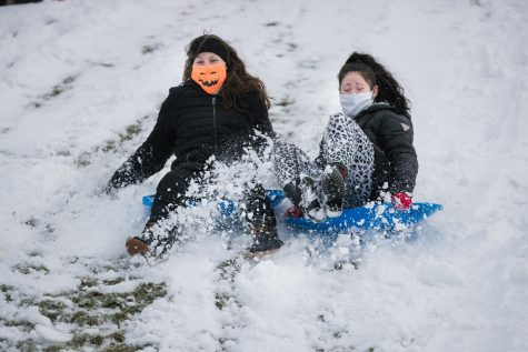 Cal U students sled riding the hills along Hickory Street near campus on Monday, Feb. 1, 2021
