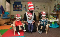 Ashley Roth, director, wears The Cat-in-the-Hat costume to read the popular children's book to toddlers at The Village in California, Pa. March 2, 2021