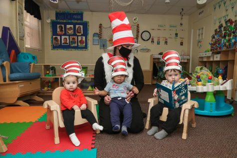Ashley Roth, director, wears the Cat-in-the-Hat costume while reading the popular children