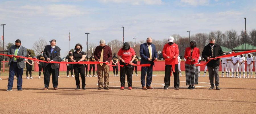 Cal U Athletics hosted a ribbon cutting ceremony for the softball team's renovated Lilley Field at Roadman Park on Tuesday, March 9, 2021. Pictured from left: Dave Garcia, vice president for Enrollment Management, Tony Mauro, vice president for University Development and Alumni Relations, Fawn Petrosky, interim vice president for Administration and Finance, Dan Engstrom, interim Provost and vice president for Academic Affairs, Natalya Smarra, assistant softball coach, Robert Thorn, interim University President, Rick Bertagnolli, head softball coach, Sheleta Camarda-Webb, interim chief officer Diversity, Equity and Inclusion, Larry Sebek, interim vice president for Student Affairs, March 9, 2021. (Jeff Helsel)