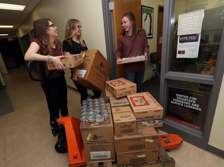 Workers of the Cal U Cupboard accepting and sorting donations in the Natali Student Center.