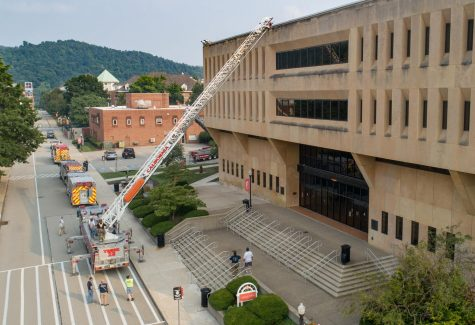 An aerial truck from the California Volunteer Fire Department is positioned in front of Manderino Library at California University of Pennsylvania as part of an emergency preparedness training exercise.