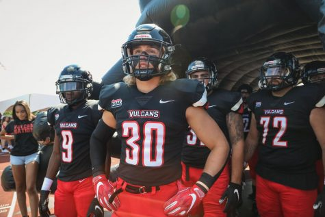 Cal U sophomore linebacker Noah Dillow (No. 30) prepares to enter the field at Adamson Stadium for the football game versus Millersville, Sept. 18, 2021