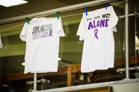Shirts of the End Violence Centers Clothesline Project hanging in the Natali Student Center, Oct. 18, 2021.  The project is a visual display that addresses the issue of domestic violence and brings awareness to its impact.