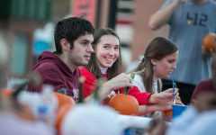 Cal U student Rebekah Schrack looks at the camera while participating in the pumpkin painting event at the Cal U Fall Fest, Oct. 20, 2021