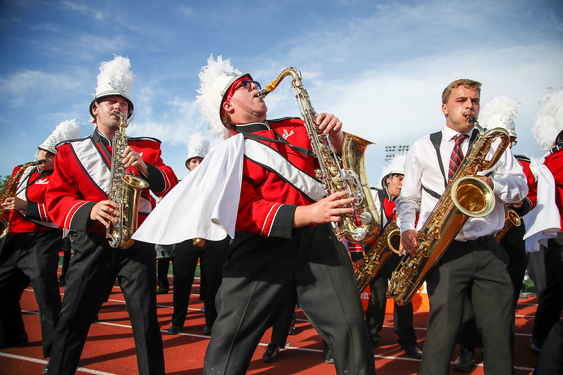 Members of the Cal U marching band exit the field following the football game halftime performance at Adamson Stadium, Oct. 2, 2021
