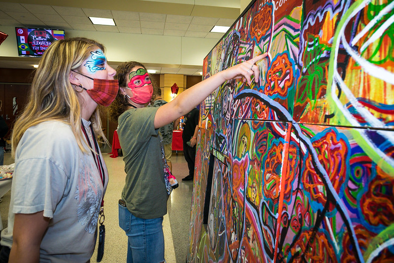 Delaney Ruth and Meghan Hartley, students at California High School, admire the artwork by Cal U professor Todd Pinkham on display at the annual Liberal Arts Festival, Convocation Center, Oct. 5, 2021.