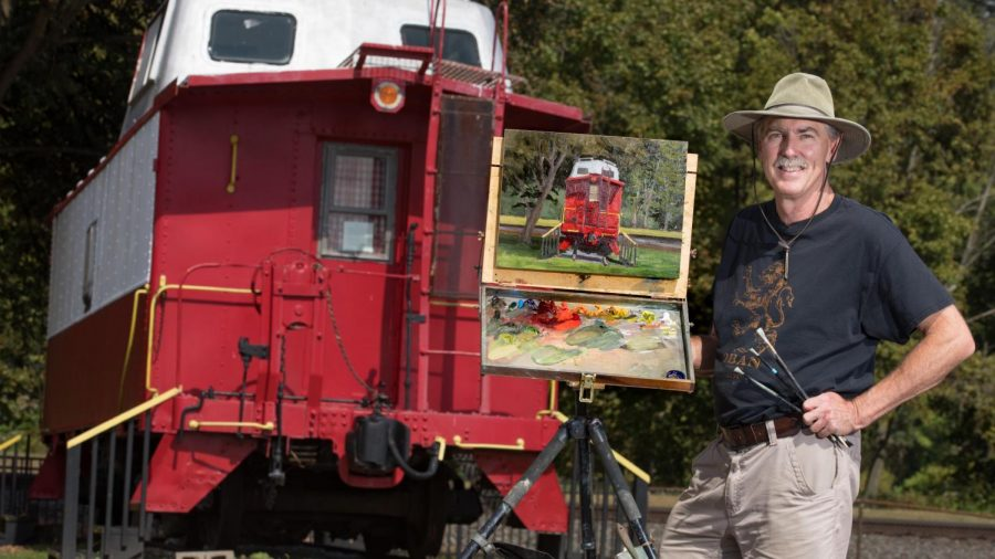 """Pittsburgh artist Ron Donoughe finishes a painting of the caboose at the California Public Library, California, Pa. The painting will be featured in the exhibition """"Brownsville to Braddock: Paintings of the Monongahela Valley"""" in the Manderino Library, Cal U, from Nov. 8 thru Dec. 3, 2021"""